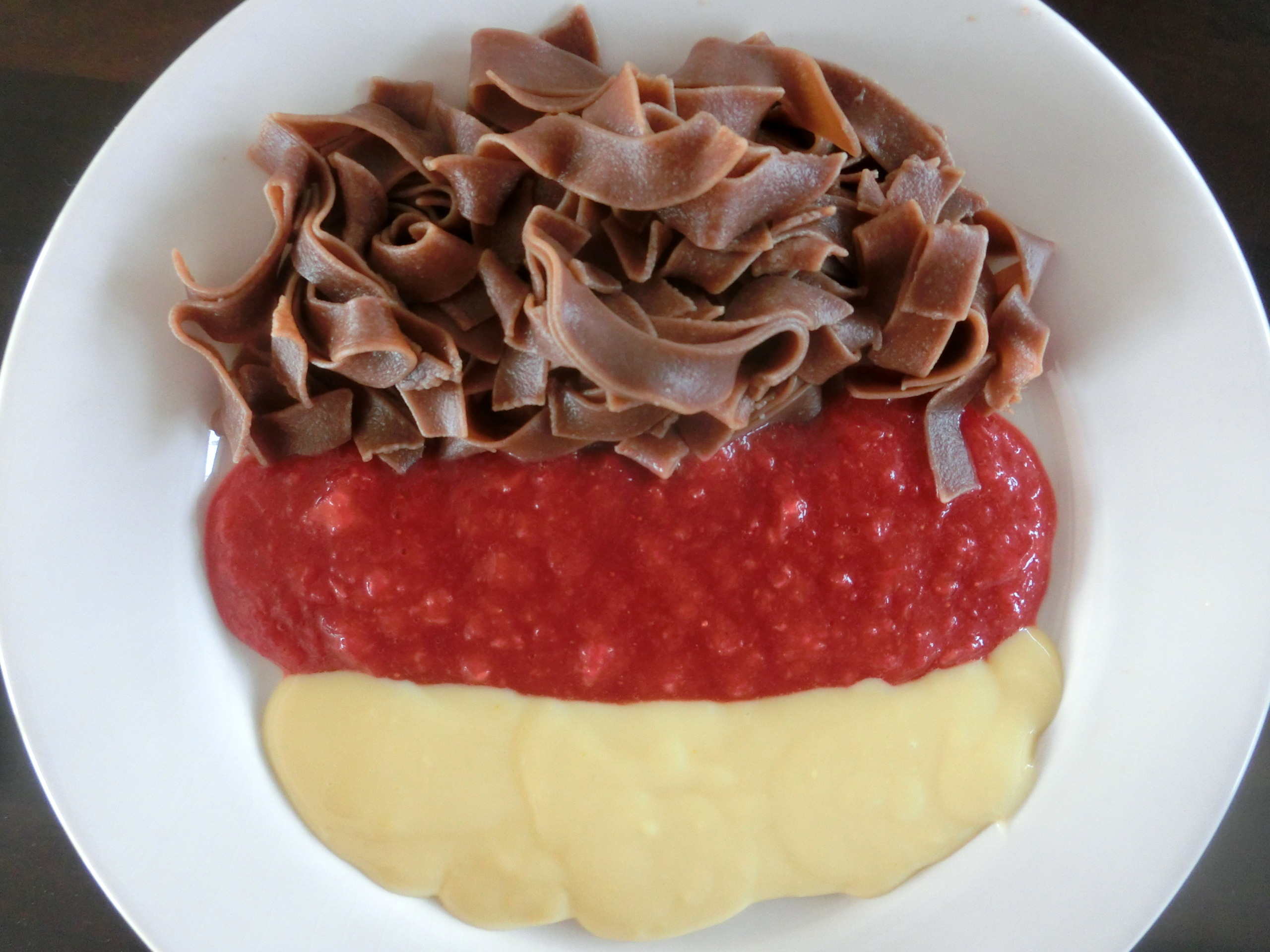 WM fever with chocolate pasta, strawberry and vanilla sauce