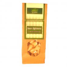 Saure Apfelstuecke in weisser schokolade